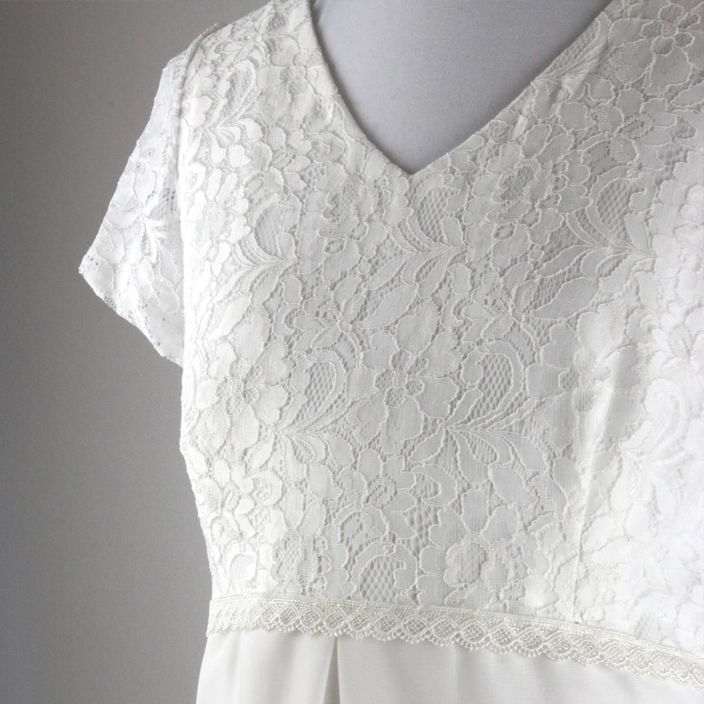 Spitzenoberteil für das Hochzeitskleid in A-linie ist elastisch und ist wunderbar zum tragen